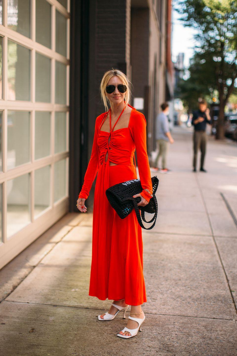 <p>Lisa Aiken wears a red, ruched Proenza Sschouler dress to see the shows. </p>