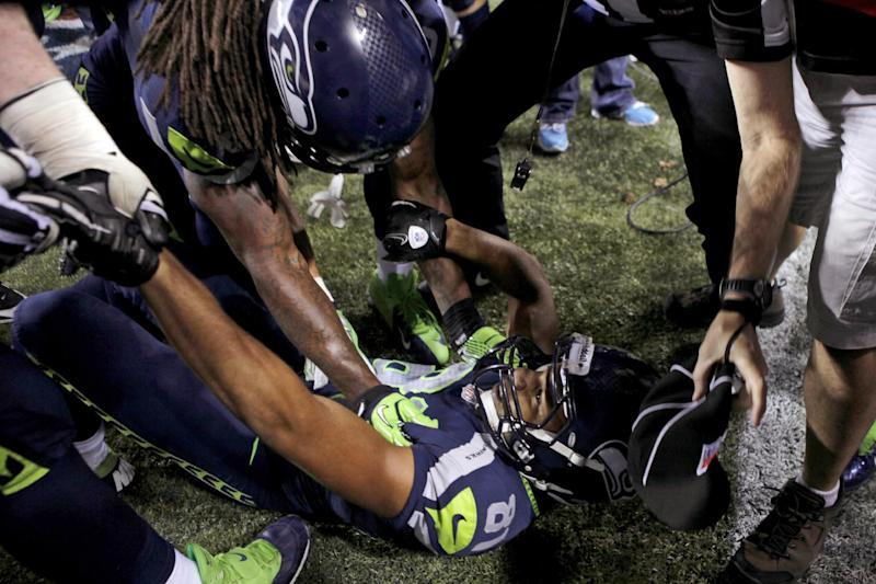 Seattle Seahawks wide receiver Golden Tate is pulled from the end zone by wide receiver Sidney Rice after scoring the winning touchdown against the Green Bay Packers in the fourth quarter of an NFL football game, Monday, Sept. 24, 2012, in Seattle. The Seahawks won 14-12. (AP Photo/Stephen Brashear)