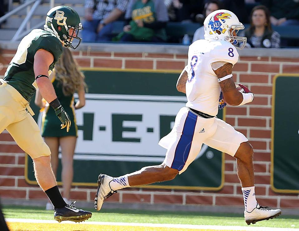 Kansas wide receiver Nick Harwell (8) scores a touchdown against Baylor safety Collin Brence (38) in the first half of an NCAA college football game, Saturday, Nov. 1, 2014, in Waco, Texas. (AP Photo/ Jerry Larson)