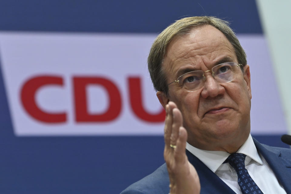 North Rhine-Westphalia's State Premier, chairman of the Christian Democratic Union party and candidate for Chancellery Armin Laschet addresses journalists after a party's leaders meeting in Berlin, Germany, Aug. 30, 2021. (Photo by John MacDougall/Pool Photo via AP)