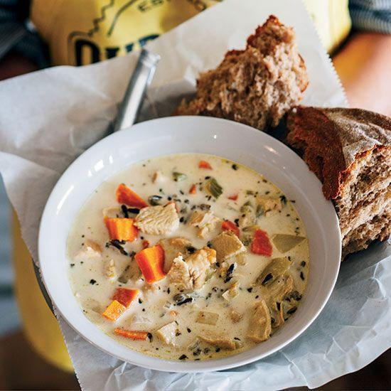 """<p>This works with leftover turkey or chicken. Wild rice and a touch of heavy cream give this delicious soup both body and flavor.</p><p><strong><a href=""""https://www.countryliving.com/food-drinks/recipes/a34725/chicken-wild-rice-soup-recipe-fw1114/"""" rel=""""nofollow noopener"""" target=""""_blank"""" data-ylk=""""slk:Get the recipe"""" class=""""link rapid-noclick-resp"""">Get the recipe</a>.</strong></p><p><strong><a class=""""link rapid-noclick-resp"""" href=""""https://www.amazon.com/Chef-Craft-12560-Inch-Silver/dp/B00LFN9Q4W/?tag=syn-yahoo-20&ascsubtag=%5Bartid%7C10050.g.1064%5Bsrc%7Cyahoo-us"""" rel=""""nofollow noopener"""" target=""""_blank"""" data-ylk=""""slk:SHOP SOUP LADLES"""">SHOP SOUP LADLES</a><br></strong></p>"""