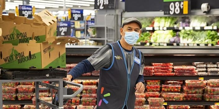 A Walmart employee seen in a mask in this corporate-supplied image.