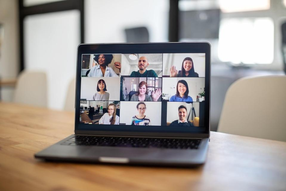 Group of business people seen on a laptop screen having an online meeting. Colleagues having a work meeting through a video call.