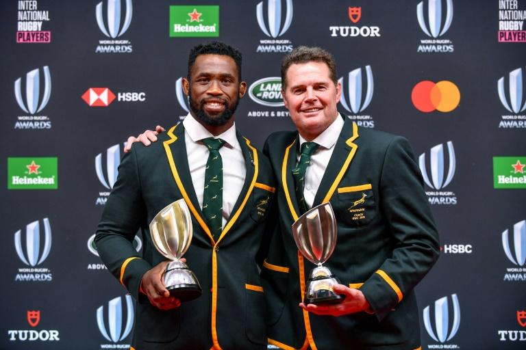 Springboks captain Siya Koliis (L) and coach Rassie Erasmus pose at the 2019 Rugby World Cup awards ceremony in Tokyo
