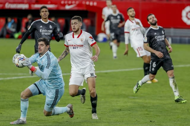 Real Madrid keeper Thibaut Courtois was called upon as Sevilla responded