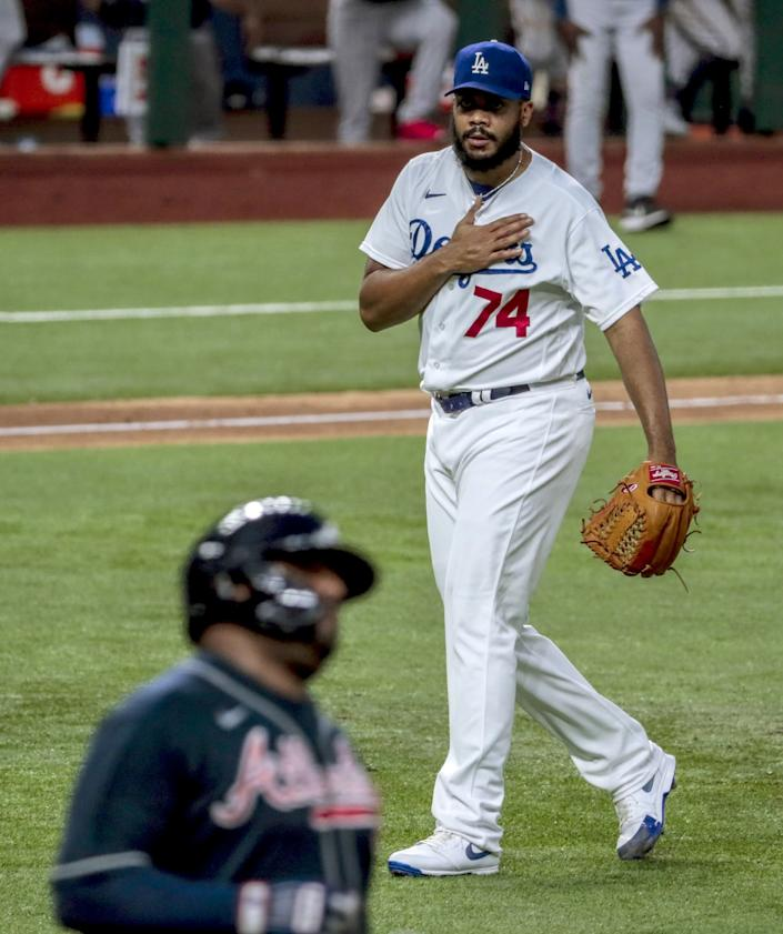 Dodgers relief pitcher Kenley Jansen taps his chest after retiring Pablo Sandoval to save a 3-1 win.