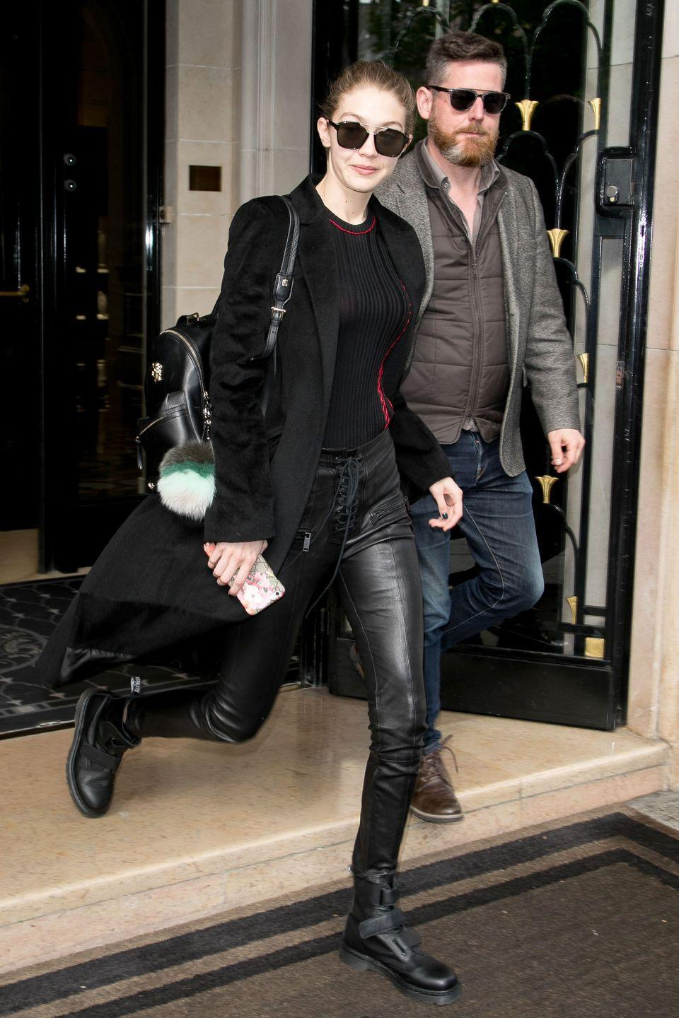 <p>In a black ribbed sweater under a Winonah long blazer coat with Unravel Project leather lace-up pants, Dr. Martens boots, and black sunglasses while out in Paris.</p>