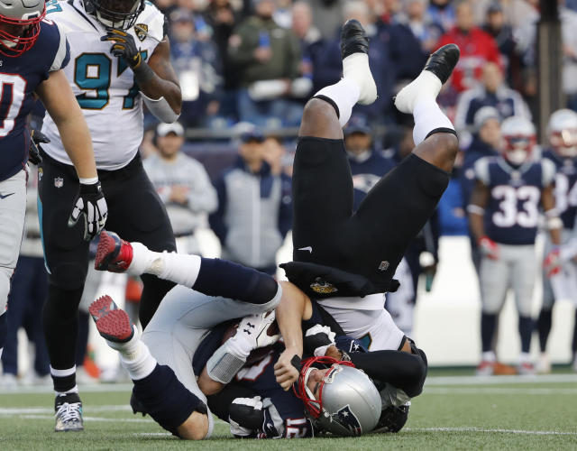 <p>New England Patriots quarterback Tom Brady, front, is sacked by Jacksonville Jaguars defensive end Dante Fowler, top, during the first half of the AFC championship NFL football game, Sunday, Jan. 21, 2018, in Foxborough, Mass. (AP Photo/Winslow Townson) </p>