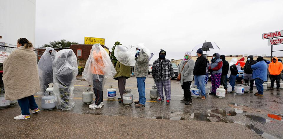 <p>People wait in line to fill propane tanks in Houston, with some standing outside for more than an hour in the freezing rain on Feb. 17. </p>