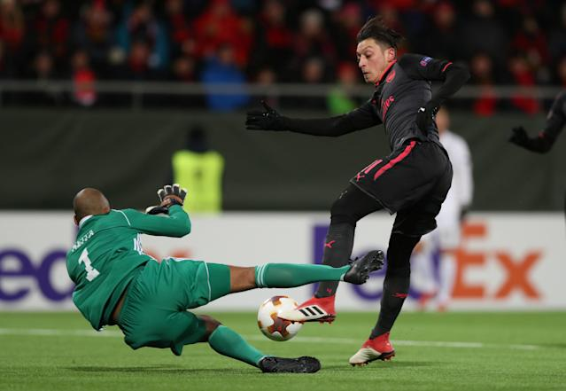 Soccer Football - Europa League Round of 32 First Leg - Ostersunds FK vs Arsenal - Jamtkraft Arena, Ostersund, Sweden - February 15, 2018 Arsenal's Mesut Ozil in action with Ostersunds FK's Aly Keita Action Images via Reuters/Peter Cziborra