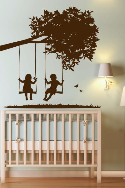 """This undated publicity photo shows WALLTAT.com's """"Kids on Swings"""" decal, a popular choice for parents decorating nurseries. Parents like the flexibility of wall decals that can be easily changed as kids grow. (AP Photo/Courtesy of WALLTAT.com)"""