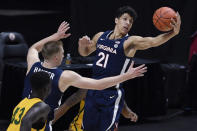Virginia's Kadin Shedrick (21) pulls in a round in the first half of an NCAA college basketball game against San Francisco, Friday, Nov. 27, 2020, in Uncasville, Conn. (AP Photo/Jessica Hill)
