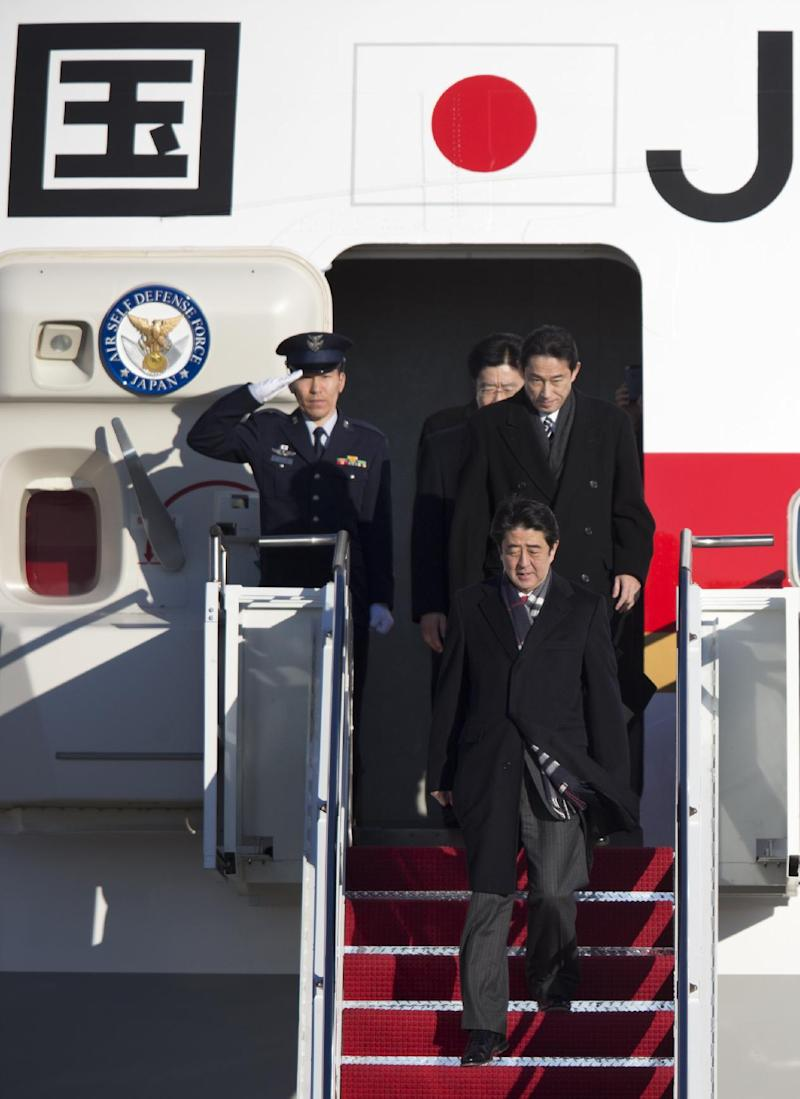 Japanese Prime Minister Shinzo Abe arrives at Andrews Air Force Base, Md., Thursday, Feb. 21, 2013.  The Japanese prime minister will meet with President Barack Obama on Friday. (AP Photo/Manuel Balce Ceneta)