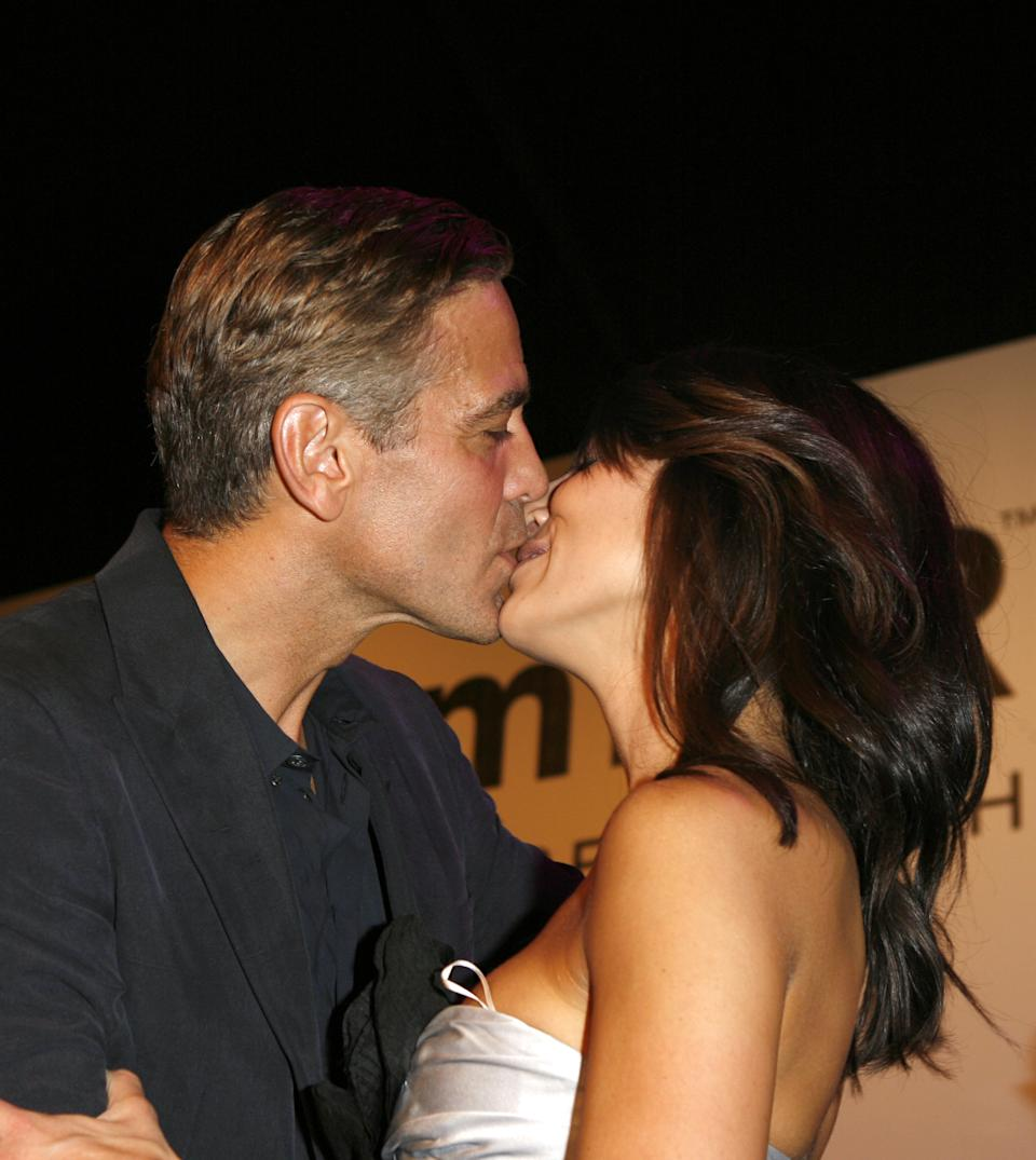 Raised $350000 for AIDS research by auctioning a kiss to a young woman.