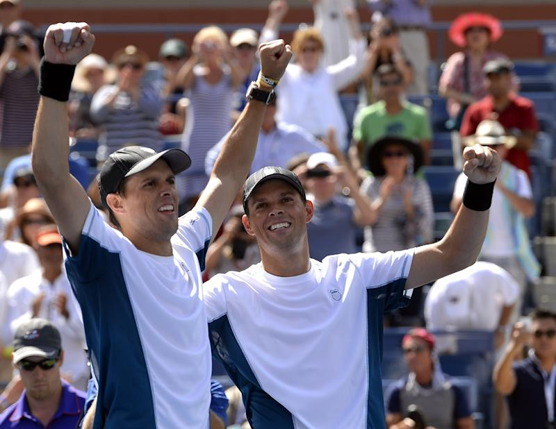 Bob (L) and Mike Bryan of the US celebrate after a match on September 7, 2014 in New York