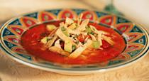 """Ancho chilies are dried Poblano chilies, and have an earthy, sweet flavor and mild heat level. Tortilla soup is a wonderfully flavorful way to use leftover turkey—substitute 1 1/2 cups finely chopped cooked turkey for the chicken, and don't skip the toppings. <a href=""""https://www.epicurious.com/recipes/food/views/ancho-tortilla-soup-56390048?mbid=synd_yahoo_rss"""" rel=""""nofollow noopener"""" target=""""_blank"""" data-ylk=""""slk:See recipe."""" class=""""link rapid-noclick-resp"""">See recipe.</a>"""