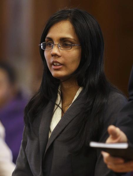Annie Dookhan, a former Massachusetts chemist accused of faking test results at a state drug lab, pleads not guilty during her arraignment at Norfolk Superior Court, in Dedham, Mass., Wednesday, Jan. 9, 2013. Prosecutors allege Dookhan fabricated test results and tampered with drug evidence while testing substances in criminal cases. (AP Photo/Steven Senne, Pool)