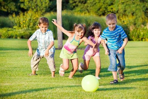 """<span class=""""caption"""">Children need a chance to rest and recharge this year more than ever.</span> <span class=""""attribution""""><a class=""""link rapid-noclick-resp"""" href=""""https://www.shutterstock.com/image-photo/boys-girls-running-towards-ball-59018779"""" rel=""""nofollow noopener"""" target=""""_blank"""" data-ylk=""""slk:2xSamara.com/ Shutterstock"""">2xSamara.com/ Shutterstock</a></span>"""