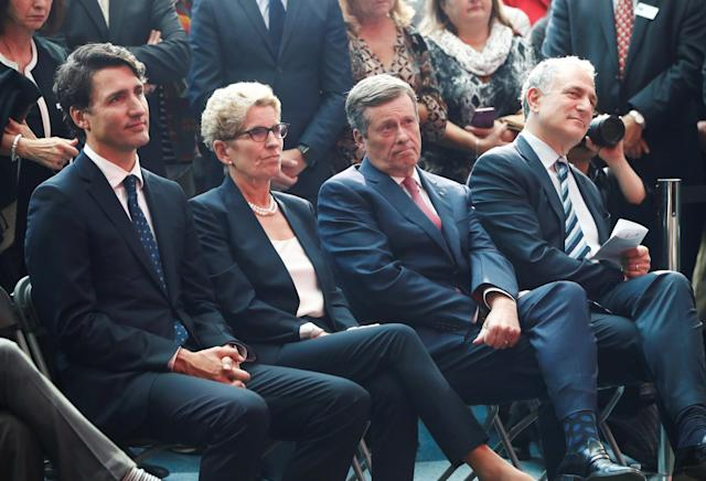 "Canada's Prime Minister Justin Trudeau (L), Ontario Premier Kathleen Wynne (2nd L), Toronto Mayor John Tory (2nd R), and Sidewalk Labs CEO Dan Doctoroff sit during a press conference where Alphabet Inc, the owner of Google, announced the project ""Sidewalk Toronto"", that will develop an area of Toronto's waterfront using new technologies to develop high-tech urban areas in Toronto, Ontario, Canada, October 17, 2017. REUTERS/Mark Blinch"