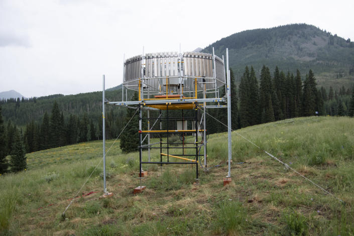 This July 14, 2021 photo provided by Lawrence Berkeley National Laboratory shows a rain gauge that will measure the amount of liquid precipitation that falls during the Atmospheric Radiation Measurement (ARM) user facility's Surface Atmosphere Integrated Field Laboratory (SAIL) field campaign in Gothic, Colo. Measurements from the rain gauge will also help scientists validate precipitation estimates from radar. (John Bilberry/Lawrence Berkeley National Laboratory via AP)