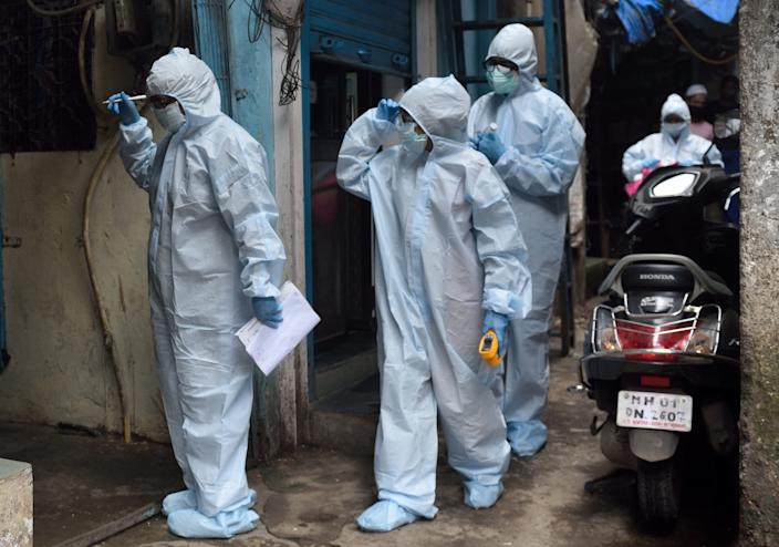 MUMBAI, INDIA - JUNE 25: A health care worker on their way to conduct the temperature and pulse rate in the Dharavi slum during Covid-19 pandemic, on June 25, 2020 in Mumbai.