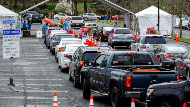 PHOTO: Cars form lines at a federally-supported drive-thru testing site for coronavirus disease at PNC Bank Arts Center in Holmdel, New Jersey, April 4, 2020. (K.C. Wilsey/FEMA via Reuters)