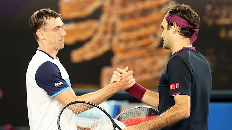 John Millman is pictured shaking hands with Roger Federer after their third-round Australian Open match.