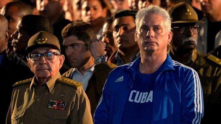 Former Cuban President Raul Castro (L) and Cuban President Miguel Diaz-Canel (R) participate in a torch march to celebrate Cuban National Hero Jose Marti in Havana, on January 27, 2020.