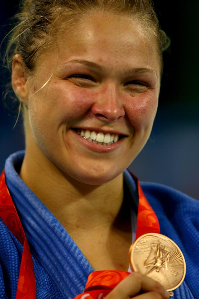 <p>MMA champion and action movie star Ronda Rousey became the first American woman to win an Olympic medal in judo when she took bronze at the 2008 Summer Games in Beijing. (Getty) </p>