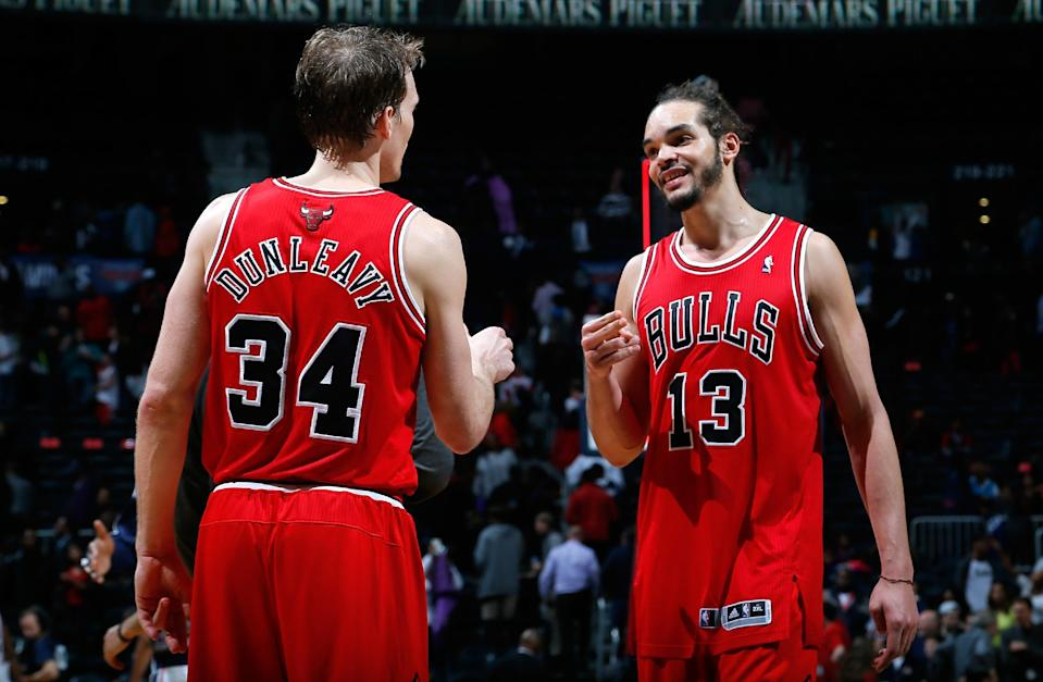 ATLANTA, GA - FEBRUARY 25: Joakim Noah #13 and Mike Dunleavy #34 of the Chicago Bulls celebrate their 107-103 win over the Atlanta Hawks at Philips Arena on February 25, 2014 in Atlanta, Georgia. (Photo by Kevin C. Cox/Getty Images)