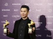 """Singapore's director Anthony Chen celebrates winning the Best New Director and Best Original Screenplay for """"Ilo Ilo"""" at the 50th Golden Horse Film Awards in Taipei November 23, 2013. REUTERS/Patrick Lin (TAIWAN - Tags: ENTERTAINMENT)"""