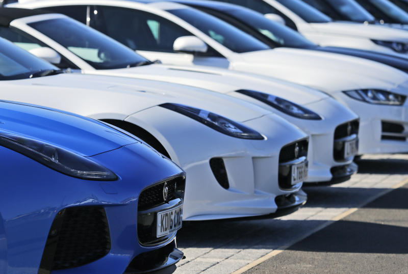 FILE - In this file photo dated Wednesday, Sept. 28, 2016, Jaguar cars are seen at a dealer outlet in London. Jaguar Land Rover has announced Friday July 5, 2019, it will retool with new equipment at Castle Bromwich, in central England, to manufacture an all-electric version of the Jaguar XJ sedan car in the U.K..(AP Photo/Frank Augstein, FILE)
