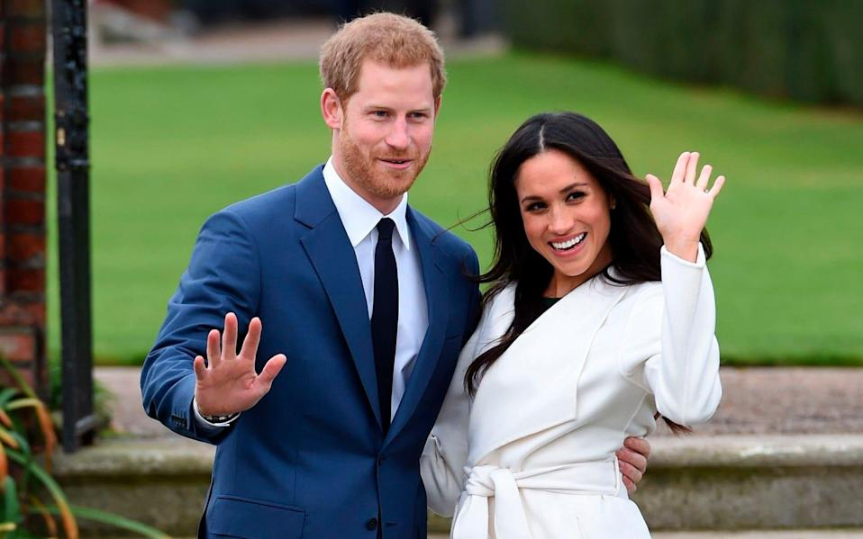 Prince Harry and Meghan Markle pose for the press after announcing their engagement in November 2017 [Photo: Getty]