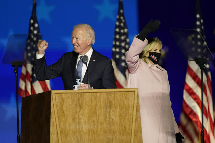 Democratic presidential candidate former Vice President Joe Biden gestures while speaking speaks to supporters, as he stands on stage with his wife Jill Biden Wednesday, Nov. 4, 2020, in Wilmington, Del. (AP Photo/Andrew Harnik)