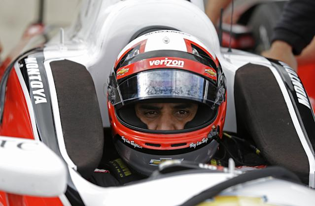 Former Indy 500 champion Juan Pablo Montoya, of Colombia, sits in his car during testing for the inaugural Grand Prix of Indianapolis auto race on the new road course at the Indianapolis Motor Speedway in Indianapolis, Wednesday, April 30, 2014. (AP Photo/Michael Conroy)