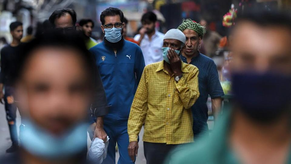 Commuters wearing masks in Delhi, India, on 14 March 2021