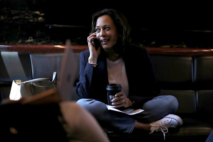 """SIOUX CITY, IOWA - AUGUST 09: Democratic presidential hopeful U.S. Sen. Kamala Harris (D-CA) talks on the phone as she rides on her campaign bus to a campaign event in Storm Lake on August 09, 2019 in Sioux City, Iowa. Kamala Harris is on a five day river-to-river bus tour across Iowa promoting her """"3AM Agenda"""" to Iowans. (Photo by Justin Sullivan/Getty Images)"""