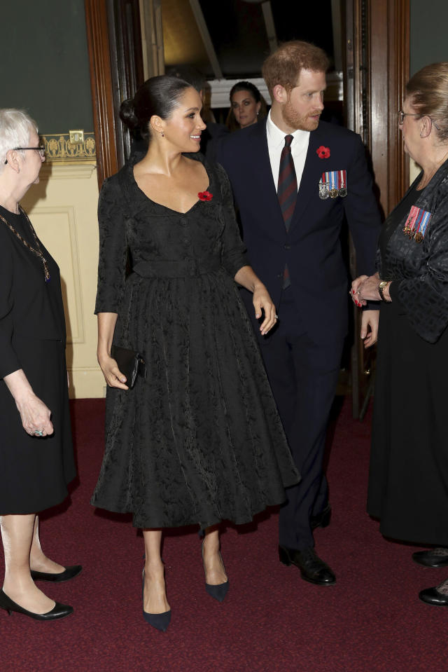 Britain's Prince Harry, right and his wife, Meghan, the Duchess of Sussex, arrive for the annual Royal British Legion Festival of Remembrance, at the Royal Albert Hall in Kensington, London, Saturday, Nov. 9, 2019. (Chris Jackson/Pool Photo via AP)