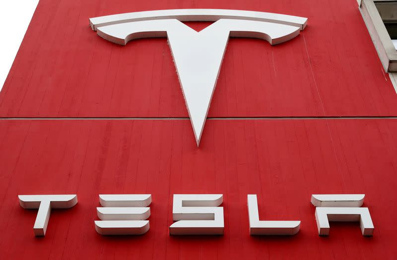 FILE PHOTO: The logo of car manufacturer Tesla is seen in Bern