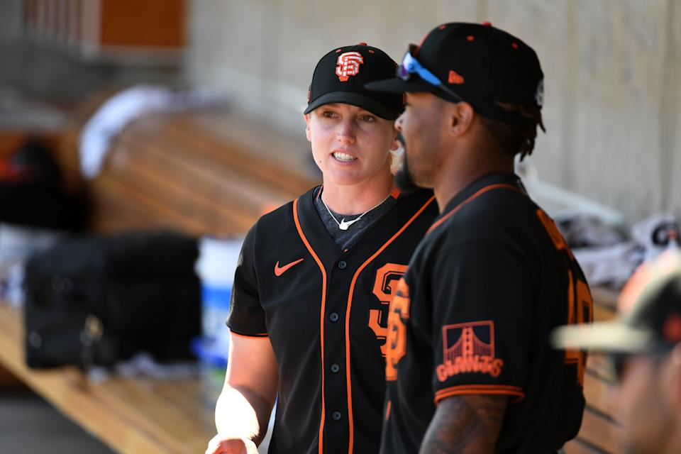 Assistant coach Alyssa Nakken #92 of the San Francisco Giants talks with Jaylin Davis #49 in the dugout prior to a spring training game against the Milwaukee Brewers at American Family Fields of Phoenix on March 06, 2020 in Maryvale, Arizona. (Photo by Norm Hall/Getty Images)