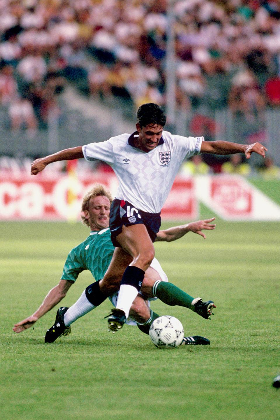 England's Gary Lineker (r) tries to get away from West Germany's Andreas Brehme (l)  (Photo by Peter Robinson - PA Images via Getty Images)