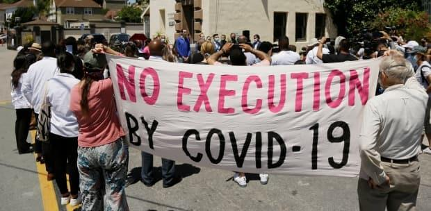 The virus ripped through prisons, including California's, where in July 2020 people protested outside San Quentin State Prison.