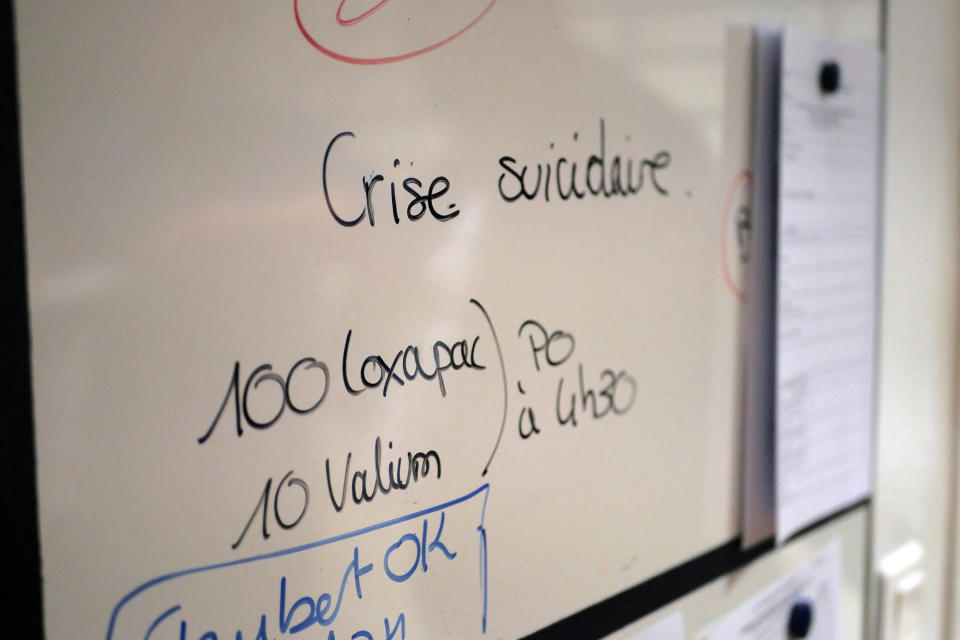 A board reads 'suicidal crisis' in the emergency ward of the Rouvray psychiatric hospital, in Rouen, western France, Wednesday, Nov. 25, 2020. Lockdowns that France has used to fight the coronavirus have come at considerable cost to mental health. Surveying points to a surge of depression most acute among people without work, in financial hardship and young adults. (AP Photo/Thibault Camus)