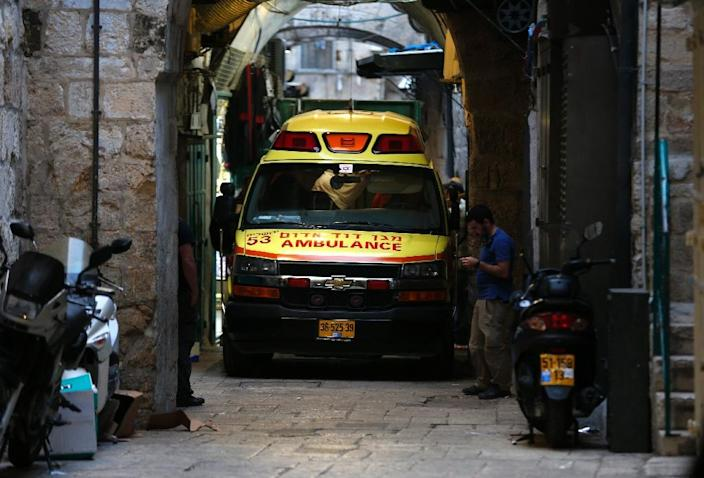 An Israeli ambulance is seen at the site of a stabbing attack by a Palestinian assailant, who was shot dead, in Jerusalem's Old City on March 18, 2018 (AFP Photo/Ahmad GHARABLI)