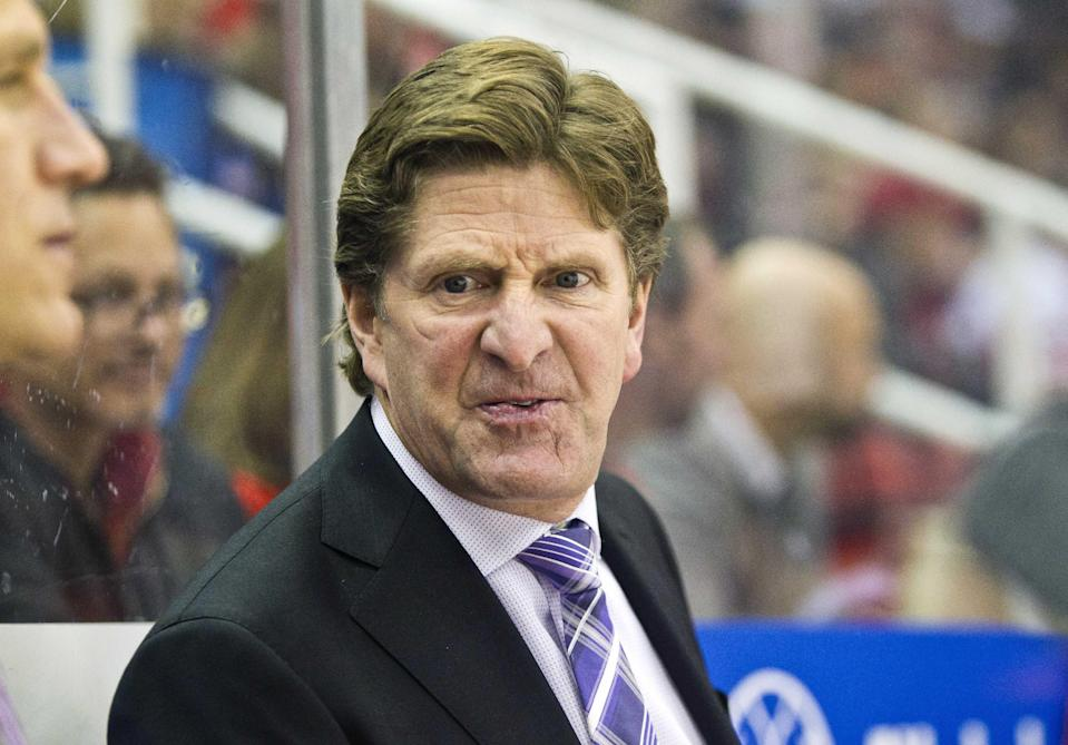 FILE - In this Nov. 24, 2014, file photo, Detroit Red Wings head coach Mike Babcock reacts on the bench during the first period of an NHL hockey game against the Ottawa Senators in Detroit. The Toronto Maple Leafs have hired Mike Babcock as their new head coach, Wednesday, May 20, 2015. (AP Photo/Tony Ding, File)