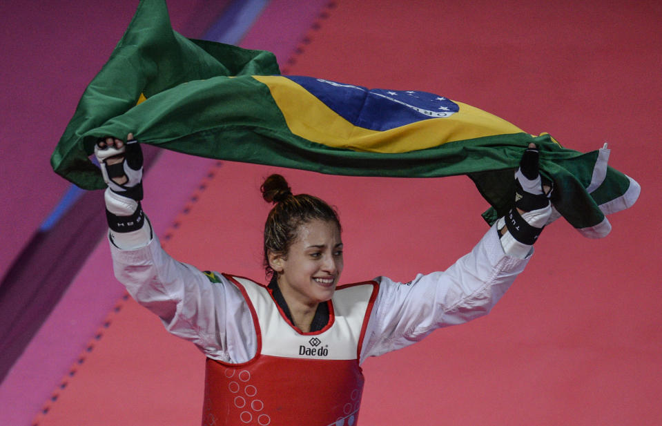 Brazil's Milena Titoneli celebrates after winning the Taekwondo Women's Under 67kg Final against US Paige McPherson during the Lima 2019 Pan-American Games, in Lima, on July 29, 2019. (Photo by Ernesto BENAVIDES / AFP)        (Photo credit should read ERNESTO BENAVIDES/AFP via Getty Images)