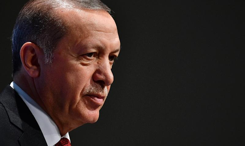 Turkey's President Recep Tayyip Erdogan says there are only two journalists behind bars in his country ahead of the trial of 17 staff from the opposition daily Cumhuriyet, despite the post-coup clampdown (AFP Photo/Tobias SCHWARZ)