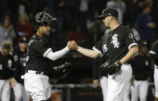 Chicago White Sox catcher Welington Castillo, left, and relief pitcher Nate Jones celebrate the team's 3-2 win over the Baltimore Orioles in a baseball game Tuesday, May 22, 2018, in Chicago. (AP Photo/Charles Rex Arbogast)