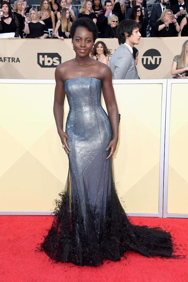 <p>Nyong'o was shining on the carpet in a shimmering mermaid gown with feather detailing. (Photo: Getty Images) </p>