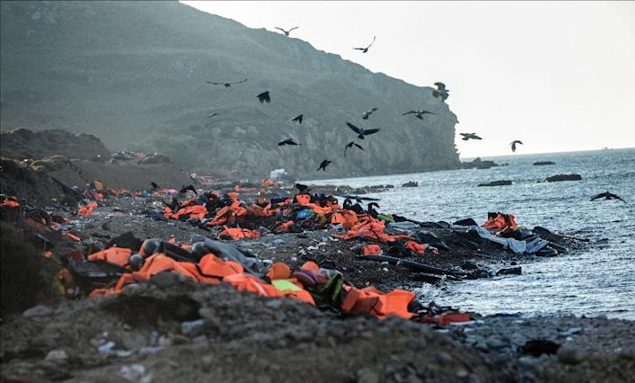 Life vests left by migrants and refugees after arriving on the shores of the Greek island of Lesbos after crossing the Aegean Sea from Turkey are seen on November 12, 2015 (AFP Photo/Bulent Kilic)